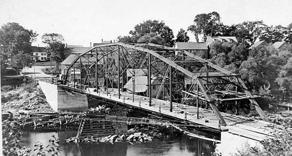 Unsafe: The iron bridge spanning the Sandy River is seen in 1916 during its construction. The bridge is expected to be torn down by March 21.