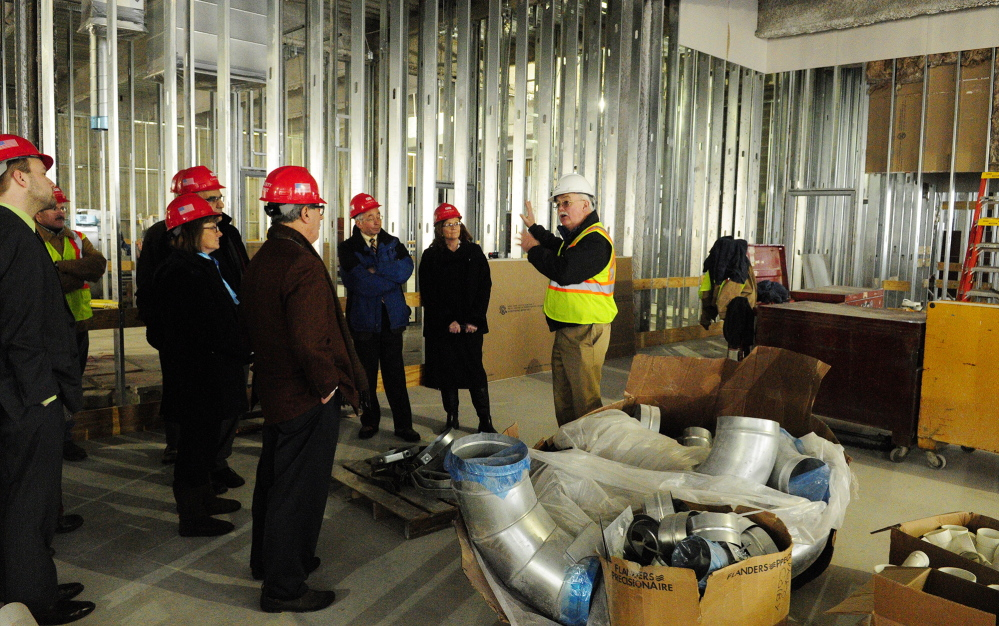 Courthouse progress: Phil Johnston, a project manager, wearing a white helmet, leads a tour for the Legislature's Judiciary Committee on Thursday at the new court building in Augusta.