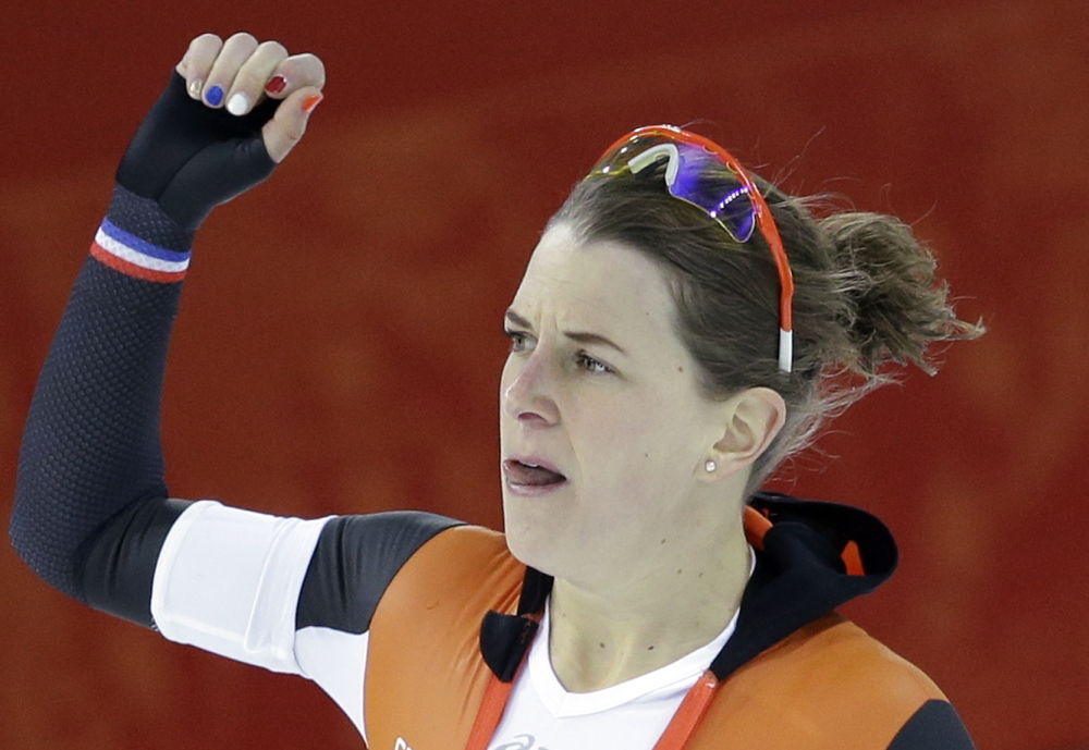 Ireen Wust of the Netherlands reacts after completing her final lap during the women's 3,000-meter speedskating race Sunday at the Adler Arena Skating Center at the 2014 Winter Olympics in Sochi, Russia.