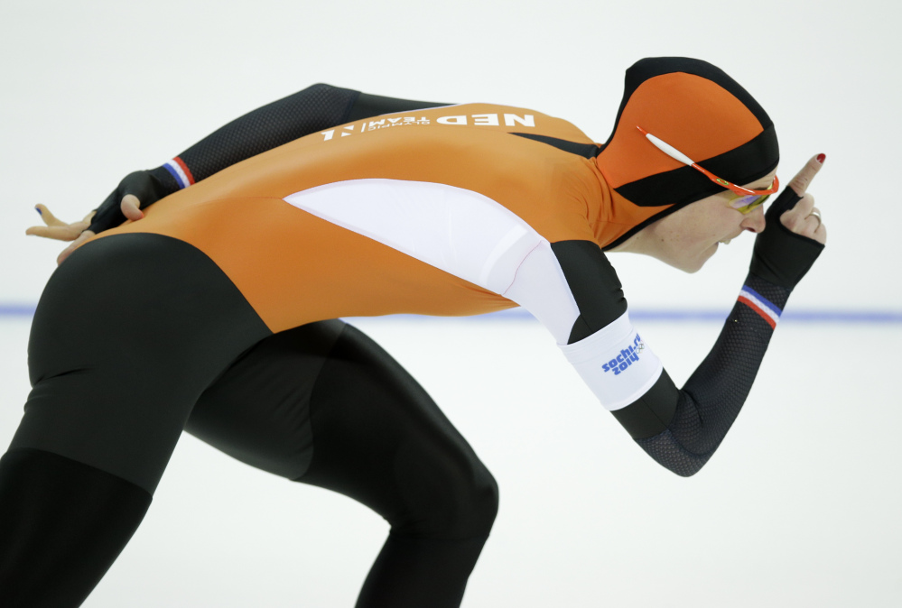 reen Wust of the Netherlands competes in the women's 3,000-meter speedskating race at the Adler Arena Skating Center during the 2014 Winter Olympics, Sunday in Sochi, Russia. Wust won the gold.