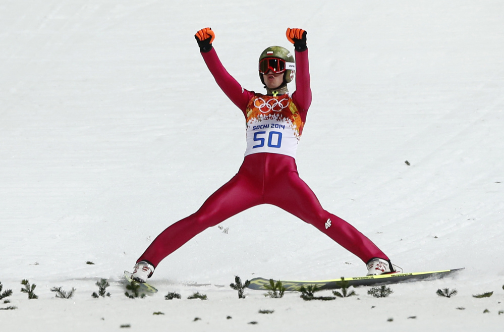 Poland's Kamil Stoch celebrates winning the gold after his second attempt during the men's normal hill ski jumping final Sunday at the 2014 Winter Olympics at Krasnaya Polyana, Russia.