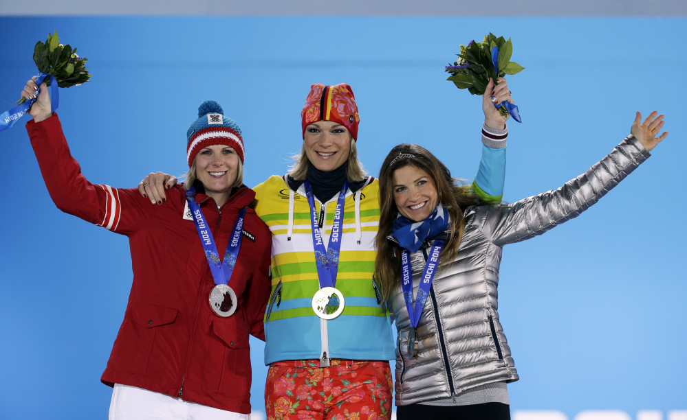 MEDALISTS: Women's super combined medalists, from left, Nicole Hosp of Austria, silver, Maria Hoefl-Riesch of Germany, gold, and Julia Mancuso of the United States, bronze, pose with their medals Monday at the 2014 Winter Olympics in Sochi, Russia.