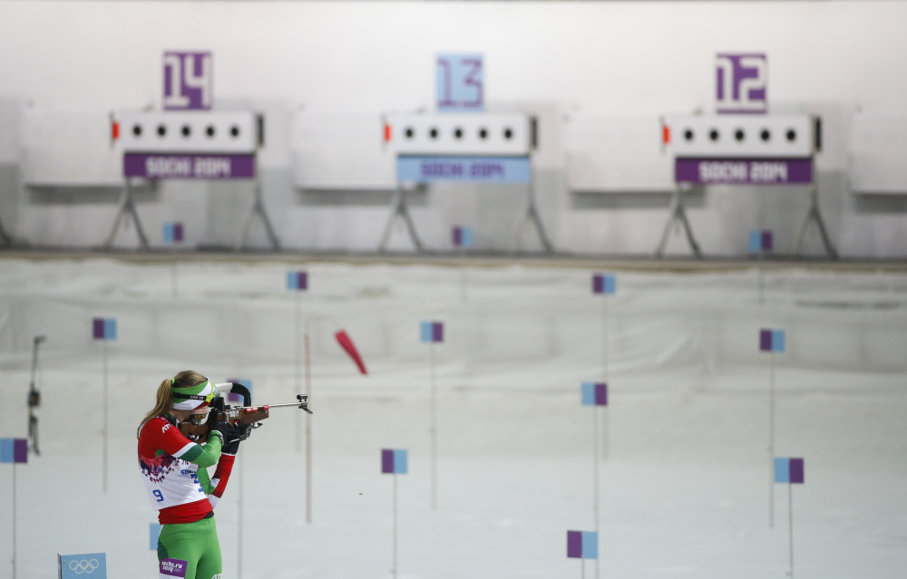Belarus' Darya Domracheva shoots on her way to win the gold medal in the women's biathlon 10k pursuit, at the 2014 Winter Olympics, Tuesday, in Krasnaya Polyana, Russia.