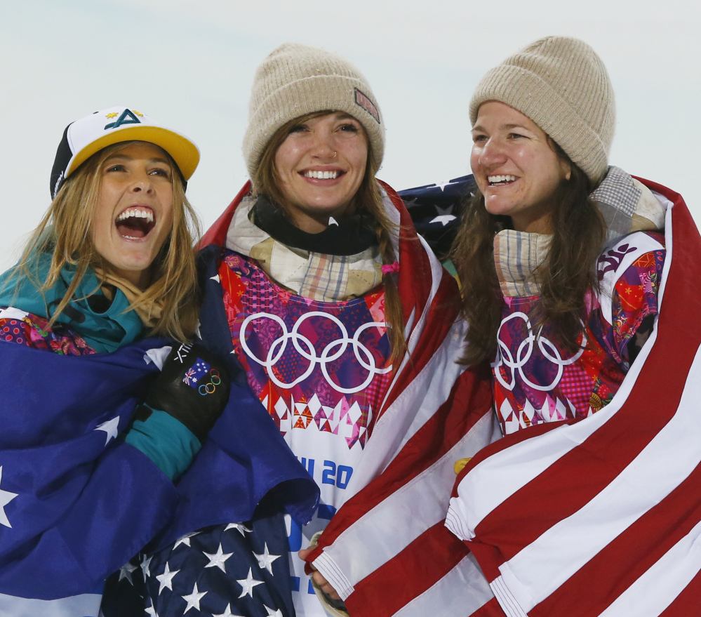 Kaitlyn Farrington, center, of the U.S. won the gold in the halfpipe Wednesday. She's flanked by Australia's Torah Bright (silver), left, and Kelly Clark (bronze) of the U.S.