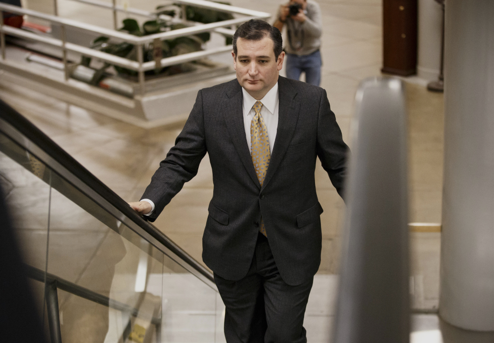 Sen. Ted Cruz, R-Texas, arrives on Capitol Hill in Washington on Wednesday as senators go to the chamber for a vote to extend the Treasury's borrowing authority.