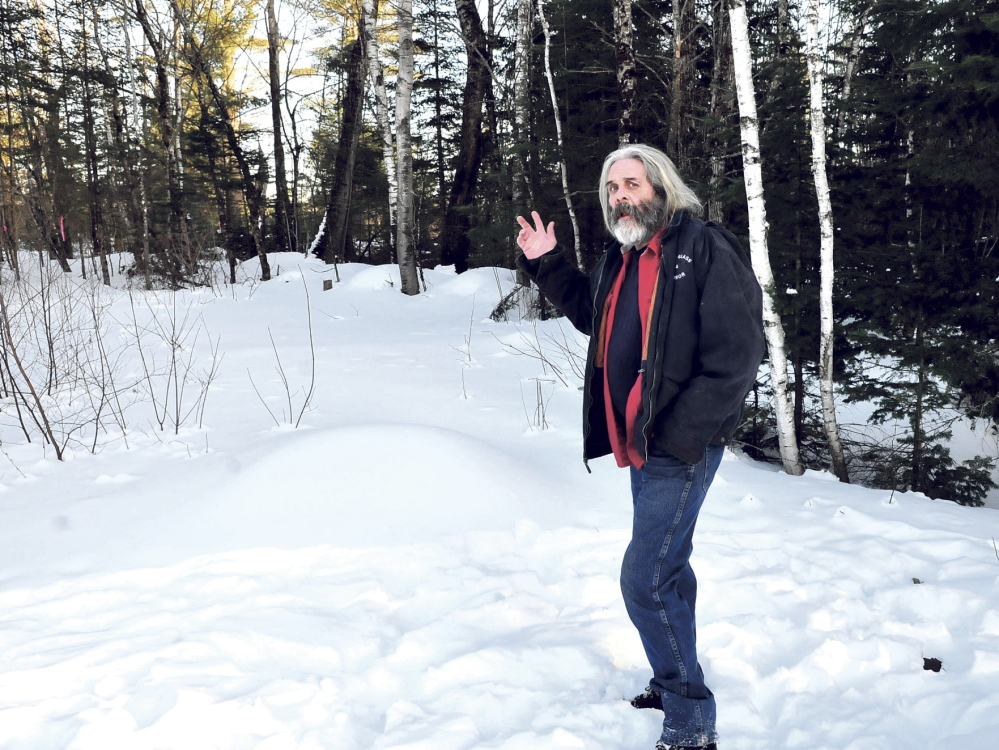 TOO CLOSE: Athens homeowner Fred Tape talks on Wednesday about the logging operation that is happening right up to his boundary line. Tape said he has asked the wood cutters to leave a buffer zone near the property line ,but without success.
