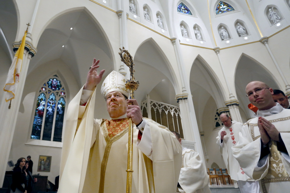The Most Rev. Robert P. Deeley blesses the congregation during the closing recessional at the Cathedral of the Immaculate Conception in Portland on Friday. Deeley will celebrate Mass at 10 a.m. Sunday at the cathedral.