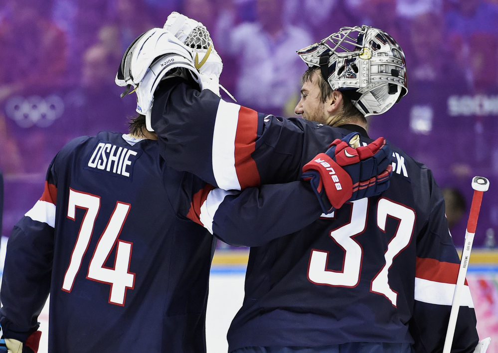 United States forward T.J. Oshie, left, congratulates goalie Jonathan Quick after defeating Russia 3-2 in a shootout in a men's hockey game at the 2014 Winter Olympics on Saturday in Sochi, Russia.