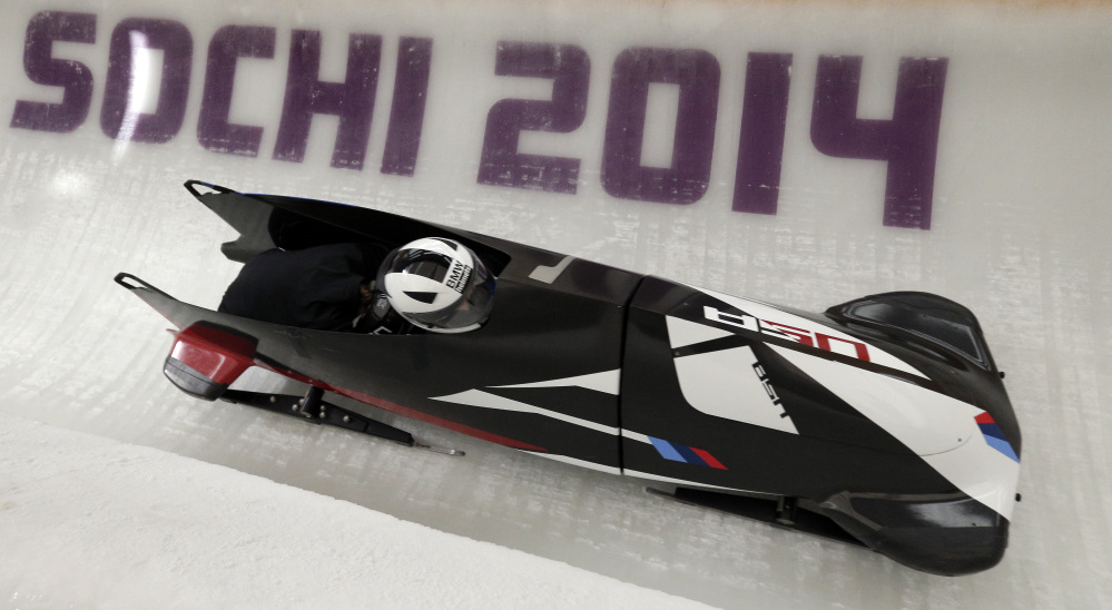 In this file photo Elena Meyers and Katie Eberling of the United States take a turn during a training session for the women's bobsleigh at the 2014 Winter Olympics Friday.