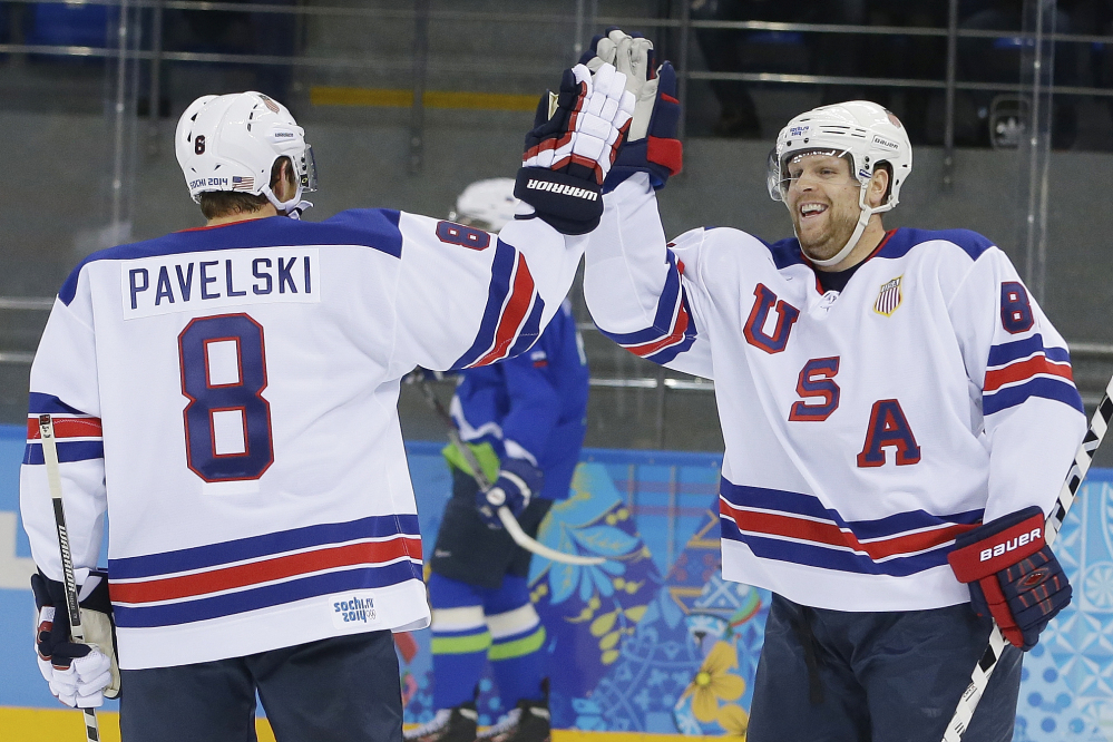 USA forward Phil Kessel, right, celebrates his second goal with teammate Joe Pavelski during the 2014 Winter Olympics men's hockey game against Slovenia at Shayba Arena Sunday in Sochi, Russia. Kessel scored three times in a 5-1 victory.