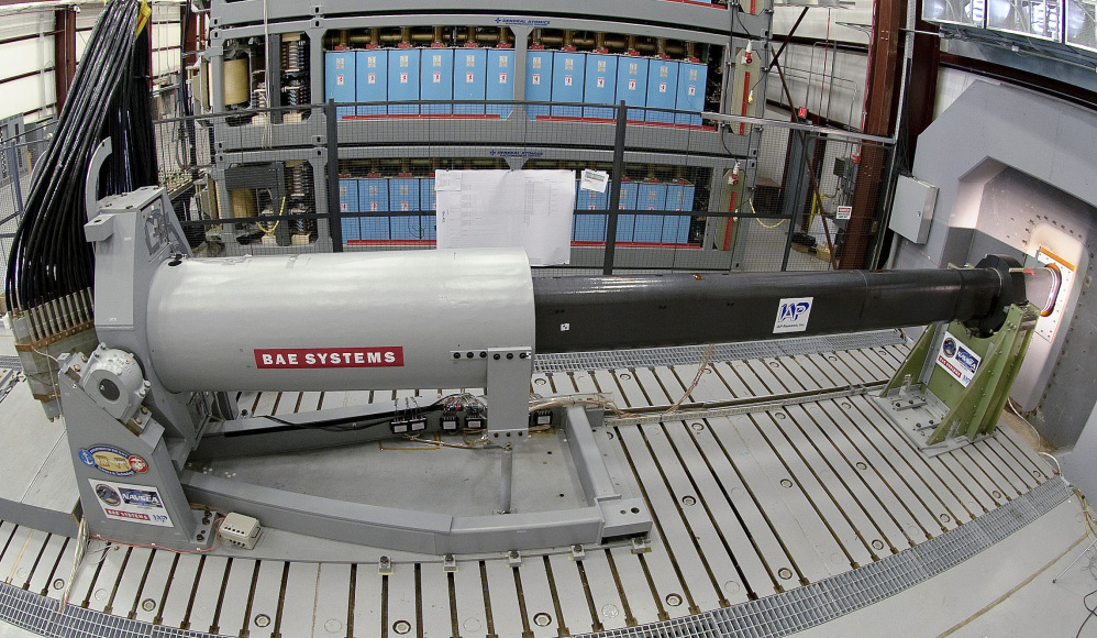 Engineers prepare to test an electromagnetic railgun prototype launcher at a test facility in Dahlgren, Va.