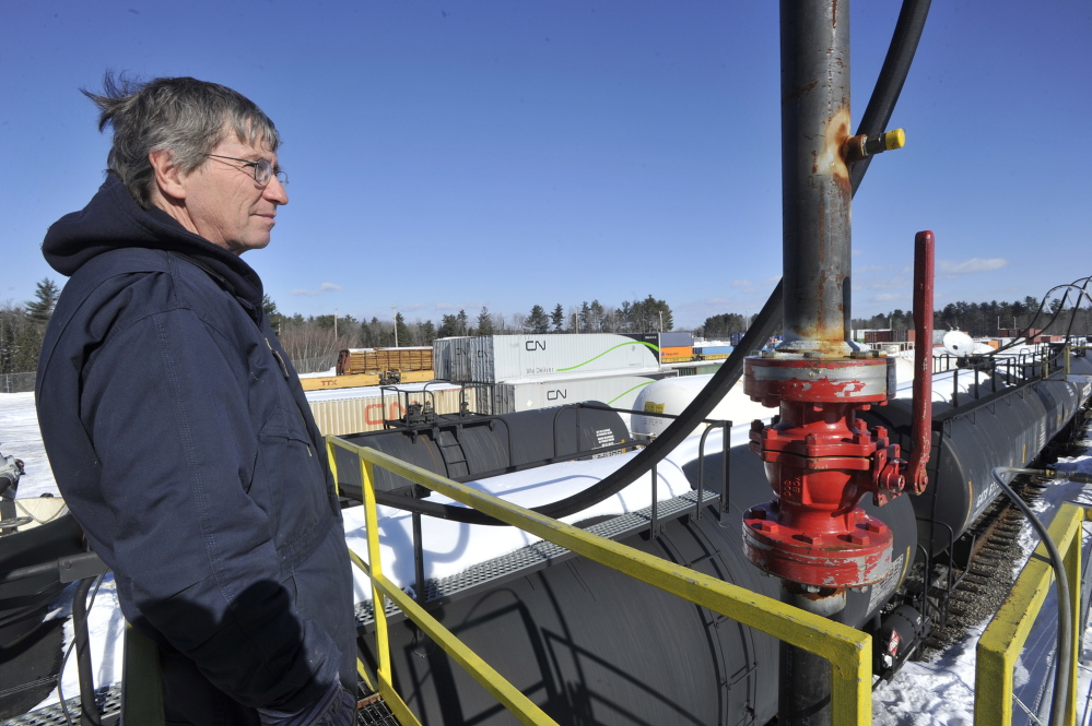 Dead River company employee Dan Printup oversees the transfer of liquid propane from the rail cars to the storage tanks last week.
