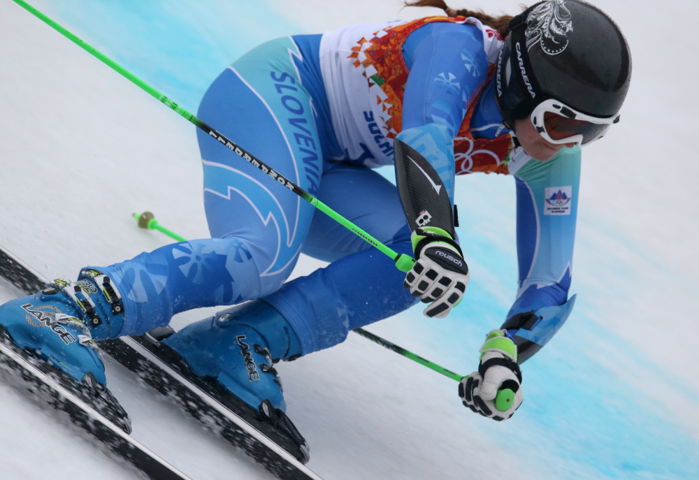 Slovenia's Tina Maze makes a turn in the second run of the women's giant slalom to win the gold medal at the Sochi 2014 Winter Olympics, Tuesday, Feb. 18, 2014, in Krasnaya Polyana, Russia.