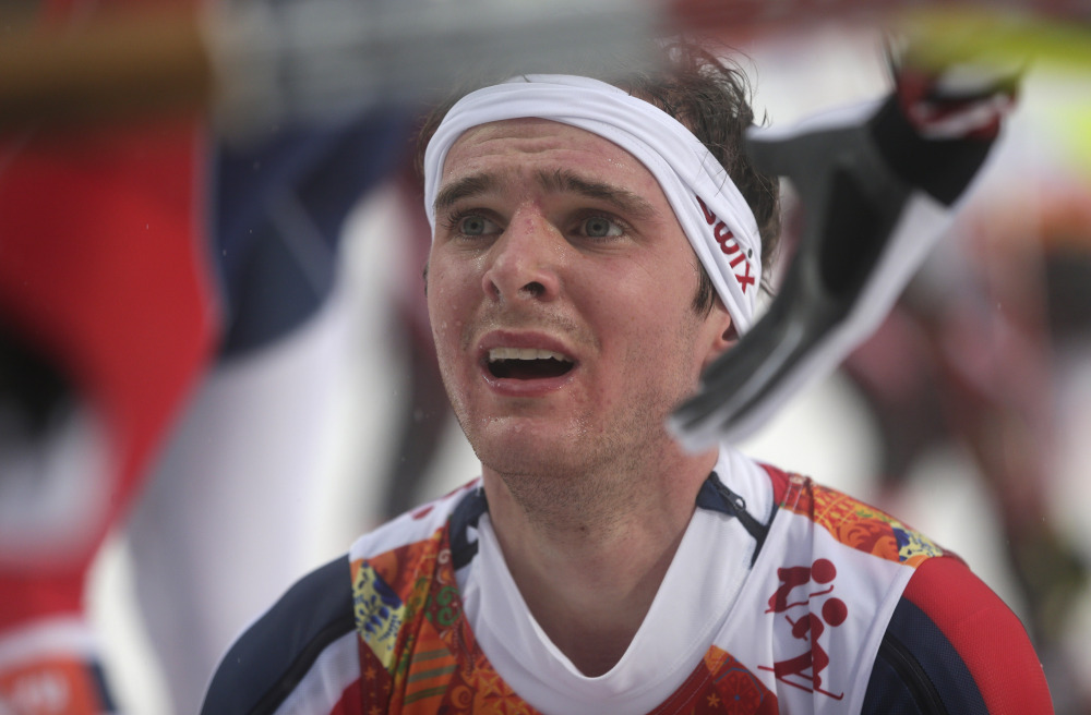 The Associated Press Norway's Joergen Graabak is congratulated after winning the gold during the Nordic combined individual Gundersen large hill competition at the 2014 Winter Olympics, Tuesday, Feb. 18, 2014, in Krasnaya Polyana, Russia.