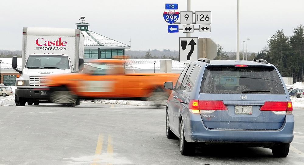 PERILOUS PLACE: Drivers entering and leaving the West Gardiner Service Plaza wait for a break in traffic on Route 9 and 126, which doesn't stop at the intersection, on Tuesday in West Gardiner. The Maine Department of Transportation is proposing a roundabout there.