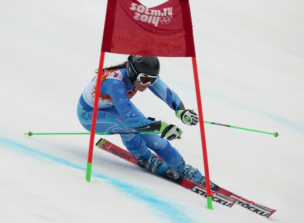 Tina Maze passes a gate in the second run of the women's giant slalom to win the gold medal at the Sochi 2014 Winter Olympics on Tuesday.