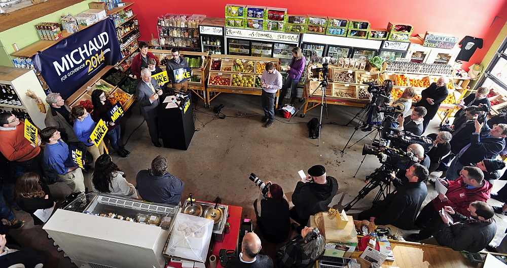 "Surrounded by supporters and media, U.S. Rep. Mike Michaud holds a news conference at Rosemont Bakery in Portland to unveil his economic plan if elected governor. ""This ... includes concrete ideas and proposals that we can start implementing on day one,"" he said."