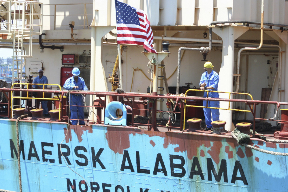 Crew members work aboard the U.S.-flagged Maersk Alabama after the ship docked in the harbour of Mombasa, Kenya, in this Nov. 22, 2009, photo.