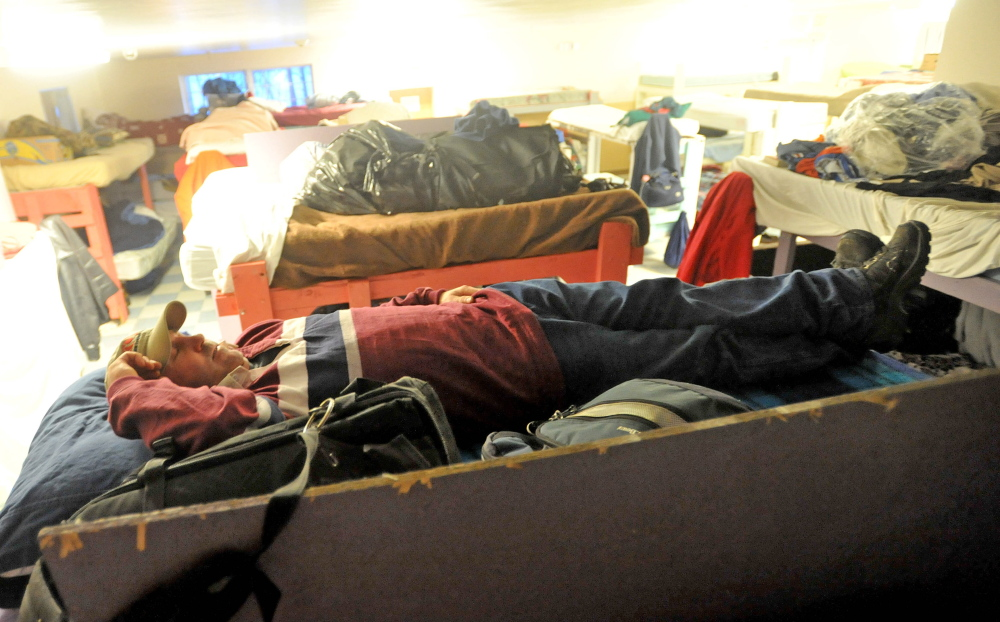 SHELTER: Dan Taylor, 43, of Winthrop, rests on his bunk Thursday at the men's shelter at Trinity Evangelical Free Church in Skowhegan. Taylor has been staying at the shelter for two weeks.