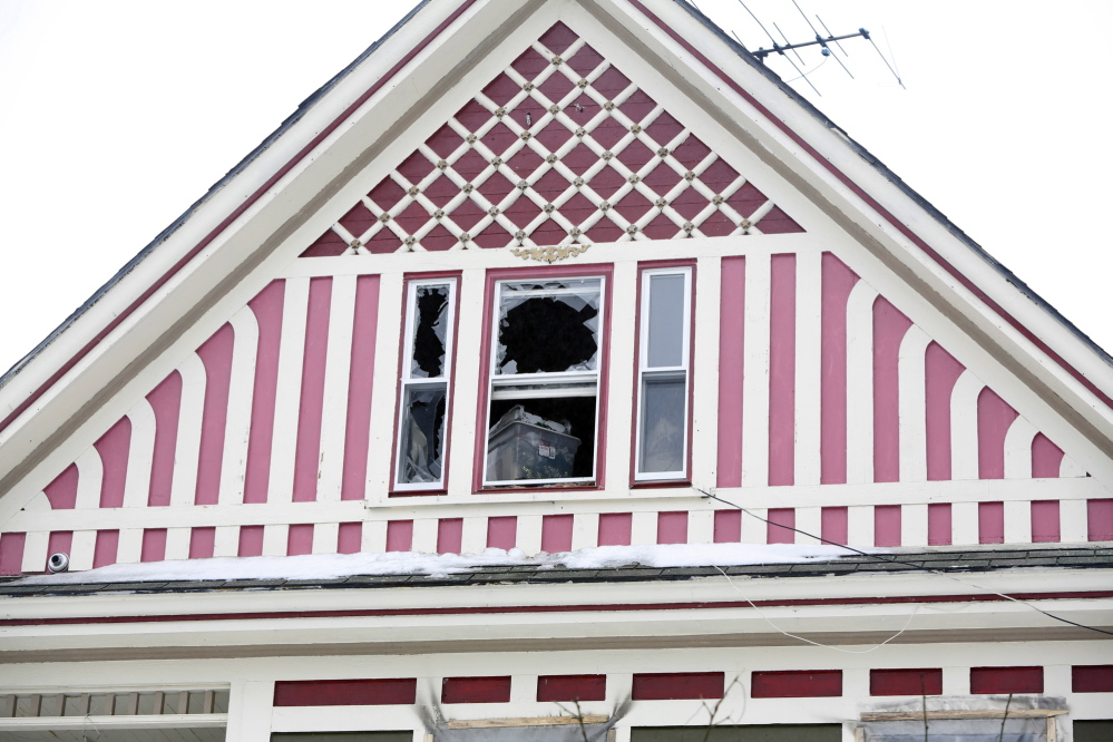 Jon Tanguay and his son Nicholas, 4, escaped a house fire from this house at 62 South St. in Bath.