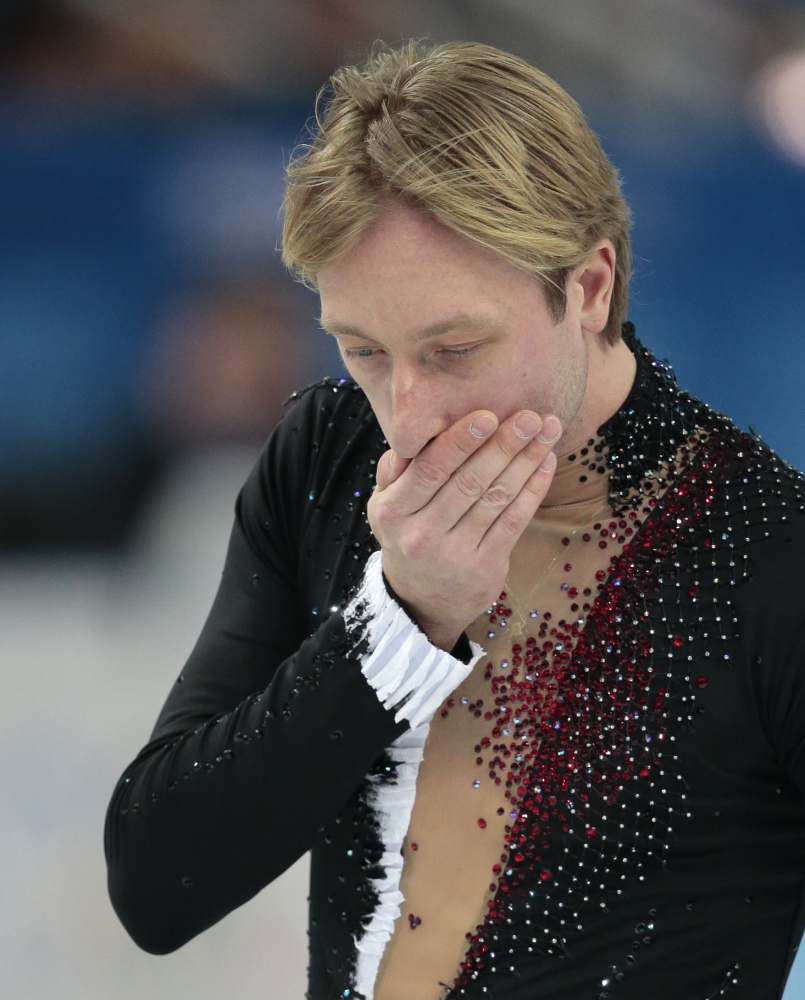 Evgeni Plushenko of Russia leaves the ice after pulling out of the men's short program figure skating competition due to illness at the Iceberg Skating Palace during the 2014 Winter Olympics on Thursday.