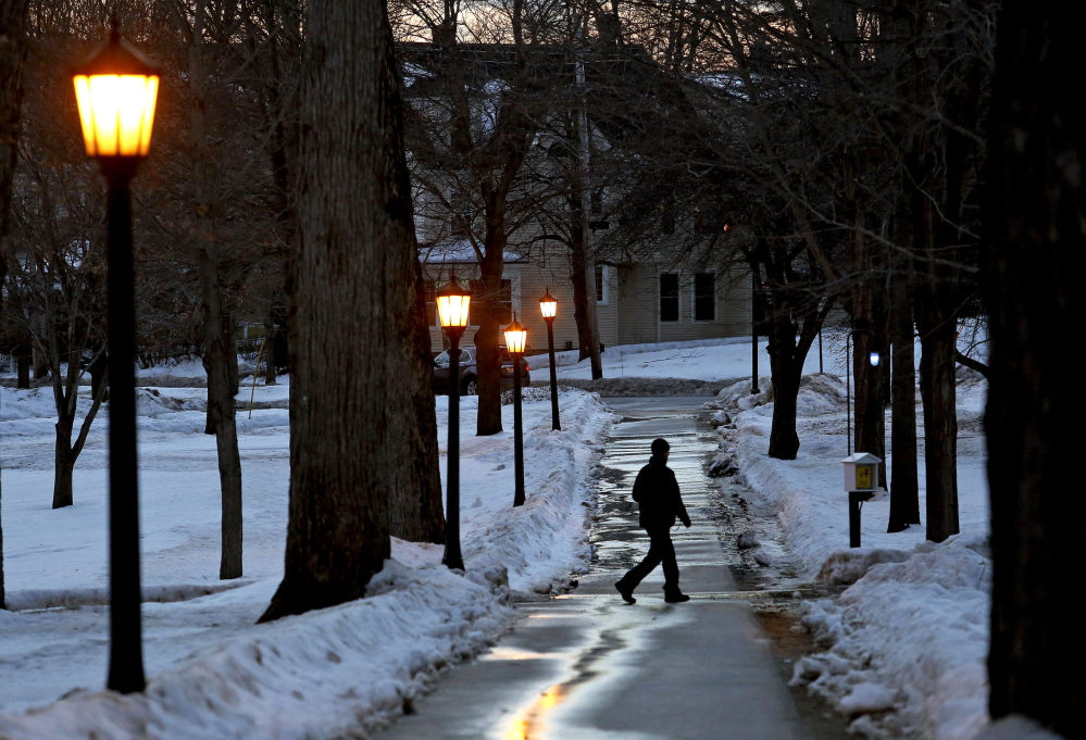 "A man strolls on the Bates College campus in Lewiston at dusk Saturday. A student from the college, John Durkin, was found dead in Rome, where he was studying. In a statement, Bates president Clayton Spencer said: ""This is a time of deep sadness for our community and for so many people who knew and loved John."""