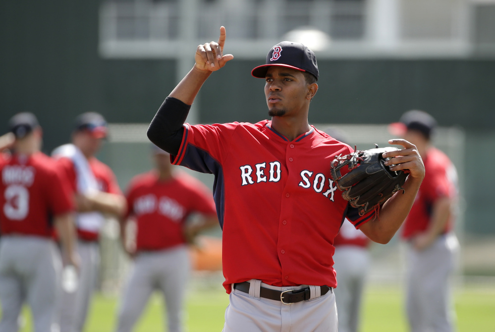 JOB HUNTING: Boston Red Sox shortstop Xander Bogaerts works out on the field during spring training Thursday in Fort Myers, Fla. Bogaerts feels he still needs to prove himself to win the shortstop starting job.