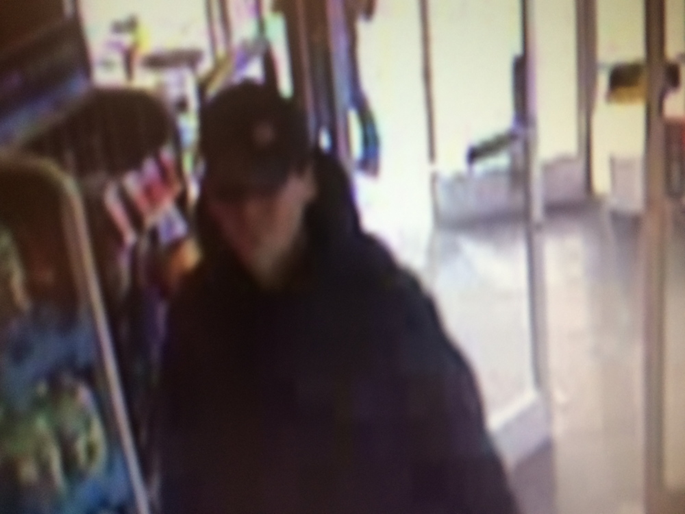 DAYLIGHT ROBBERY: Security camera footage shows a suspect in a robbery at Rite Aid pharmacy in Winslow Monday.