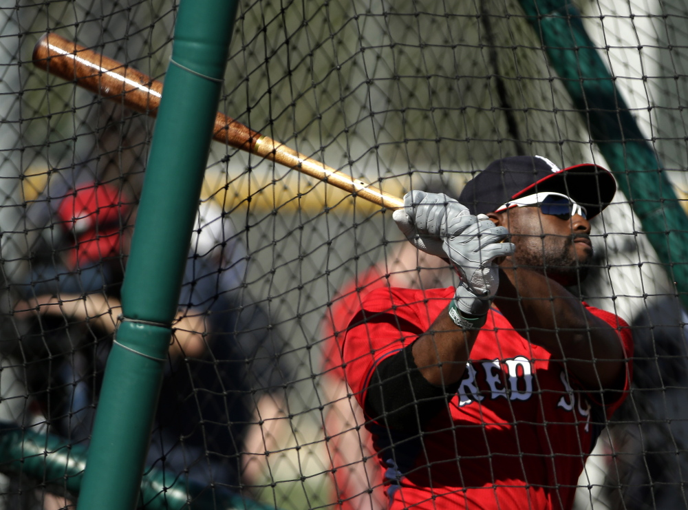 Boston Red Sox center fielder Jackie Bradley Jr. follows through on a swing at batting practice during spring training baseball practice this month in Fort Myers, Fla.
