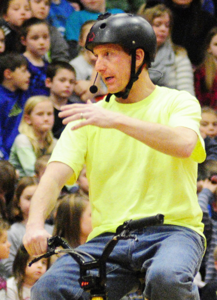 LIFE TRICKS: World Champion Bicycle Stunt Rider, Motivational Speaker and Author Chris Poulos's talks to Cottrell School students in the Foster Memorial Gym at Monmouth Academy about bullying and other topics on Friday.