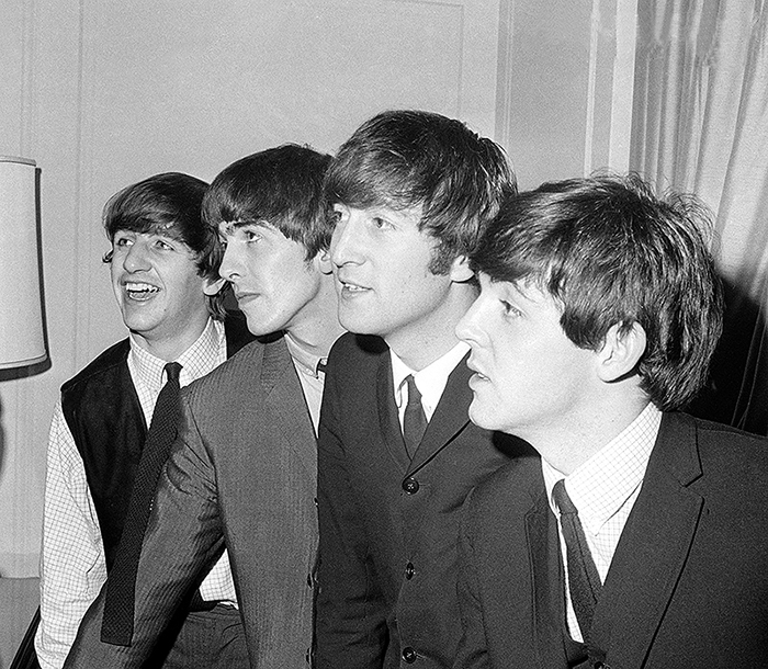 The Beatles, from left, Ringo Starr, George Harrison, John Lennon and Paul McCartney, are shown in their New York hotel after their arrival on Feb. 7, 1964. Nine days later, the Beatles made their second TV appearance on the Ed Sullivan Show, which was broadcast live from the Napoleon Ballroom of the Deauville Hotel in Miami Beach.