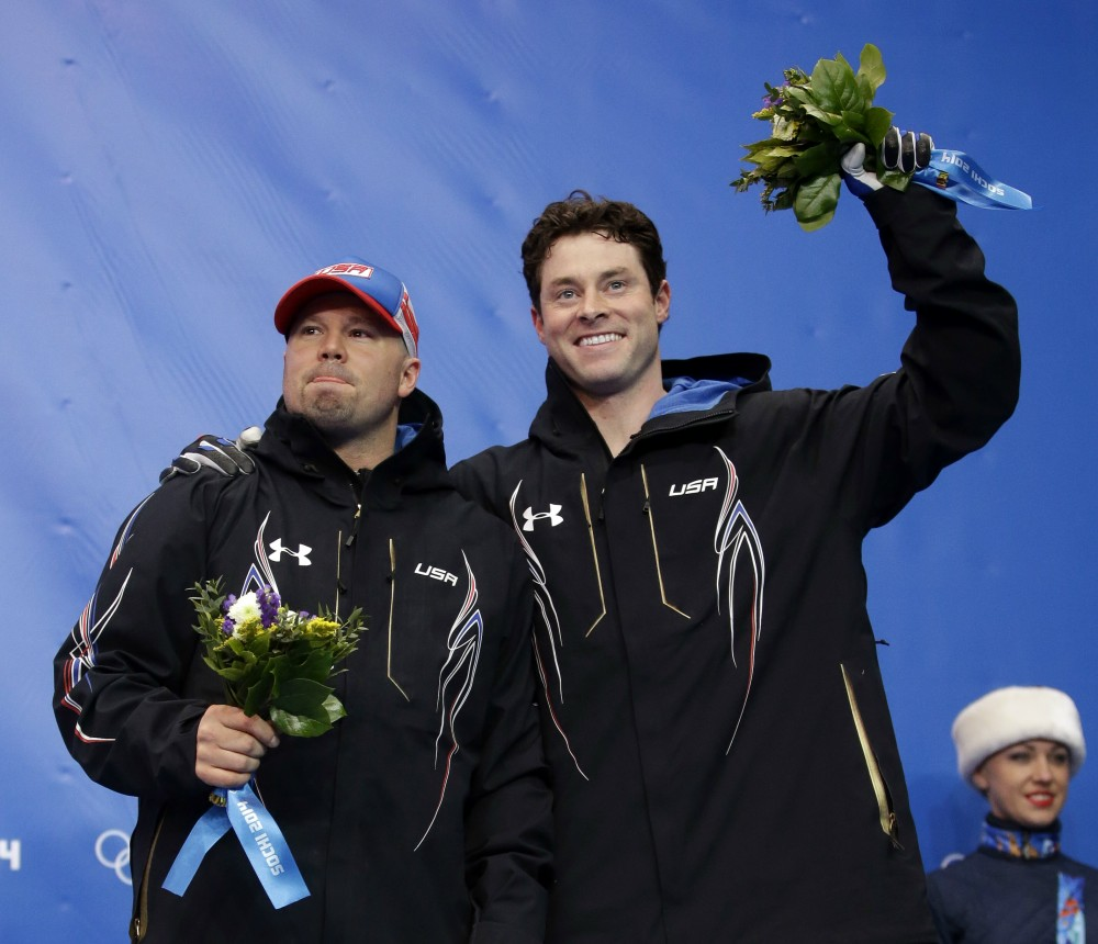 The team from the United States USA-1, piloted by Steven Holcomb and brakeman Steven Langton, celebrate their bronze medal win after the men's two-man bobsled competition at the 2014 Winter Olympics, Monday, Feb. 17, 2014, in Krasnaya Polyana, Russia. (AP Photo/Dita Alangkara) 2014 Sochi Olympic Games,Winter Olympic games,Olympic games,Sports,Events,XXII Olympic Winter Games