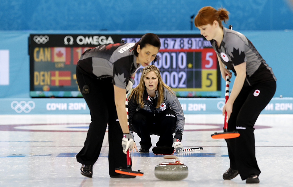 Canada's skip Jennifer Jones, center, watches her teammates Jill Officer, left, and Dawn McEwen, right, during the women's curling competition against Denmark at the 2014 Winter Olympics, Thursday, Feb. 13, 2014, in Sochi, Russia. (AP Photo/Wong Maye-E) 2014 Sochi Olympic Games;Winter Olympic games;Olympic games;Spor