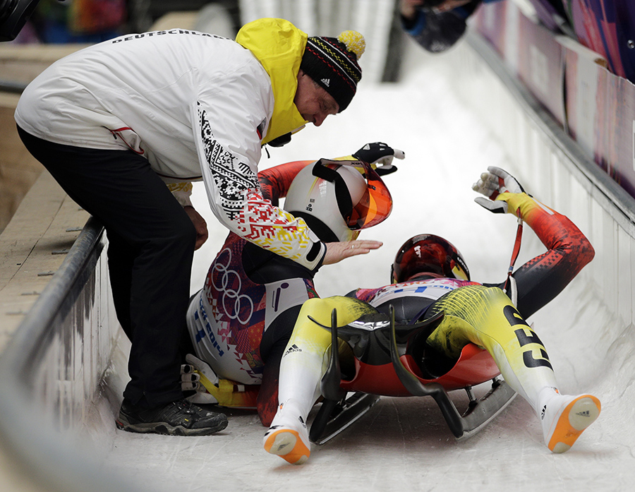 The doubles team of Tobias Wendl and Tobias Arlt from Germany celebrate in the finish area after their final run to win the gold medal during the men's doubles luge at the 2014 Winter Olympics, Wednesday, Feb. 12, 2014, in Krasnaya Polyana, Russia.
