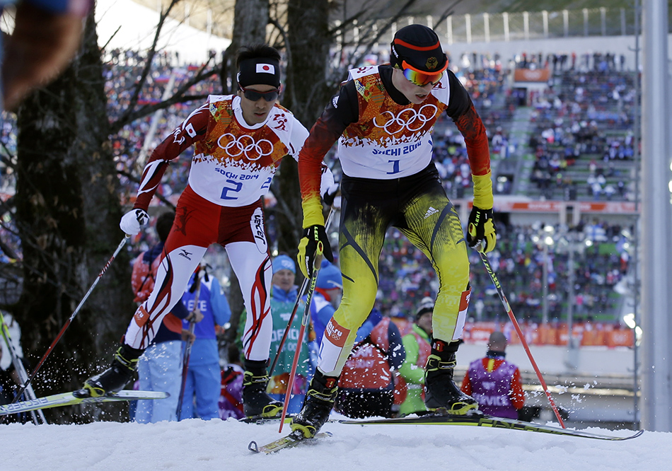 Germany's gold medal winner Eric Frenzel, right, and Japan's silver medal winner Akito Watabe ski during the cross-country portion of the Nordic combined at the 2014 Winter Olympics, Wednesday, Feb. 12, 2014, in Krasnaya Polyana, Russia.