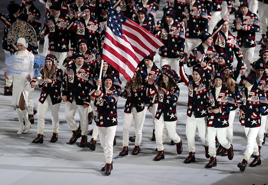 Todd Lodwick of the United States carries his country flag as the team arrives during the opening ceremony of the 2014 Winter Olympics in Sochi, Russia, on Friday.
