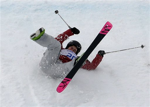 Canada's Yuki Tsubota crashes on her last run in the women's freestyle skiing slopestyle final at the Rosa Khutor Extreme Park, at the 2014 Winter Olympics, Tuesday, Feb. 11, 2014, in Krasnaya Polyana, Russia.