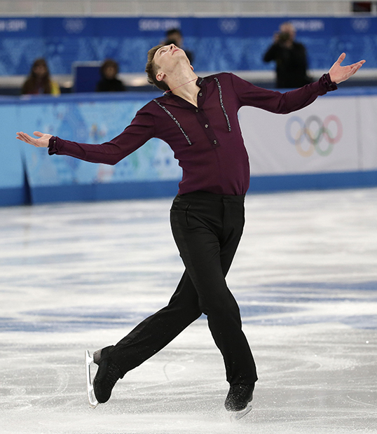 Jeremy Abbott of the United States competes in the men's team short program figure skating competition at the Iceberg Skating Palace during the 2014 Winter Olympics, Thursday, Feb. 6, 2014, in Sochi, Russia.