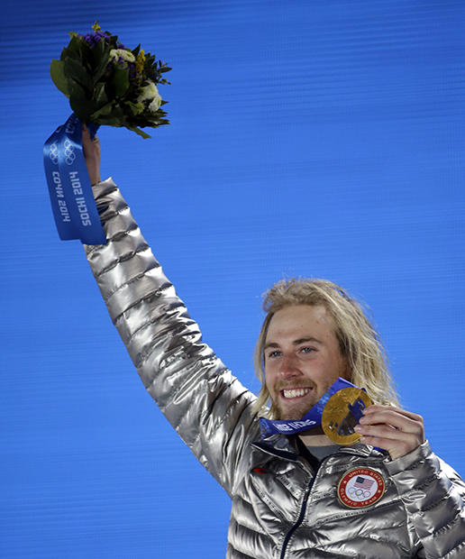 Gold medalist Sage Kotsenburg, of the United States, holds up his medal during the medal ceremony for the Snowboard Men's Slopestyle competition at the 2014 Winter Olympics, Saturday, Feb. 8, 2014, in Sochi, Russia.