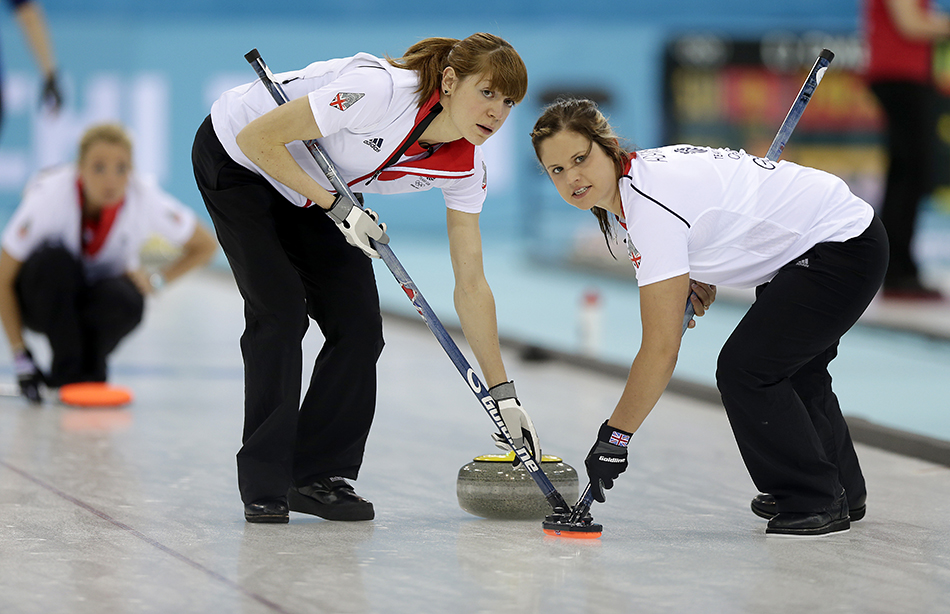 Great Britain's Claire Hamilton, right, and Anna Sloan, right, sweep the ice during the women's curling competition against Sweden at the 2014 Winter Olympics, Monday, Feb. 10, 2014, in Sochi, Russia. (AP Photo/Wong Maye-E) 2014 Sochi Olympic Games;Winter Olympic games;Olympic games;Spor