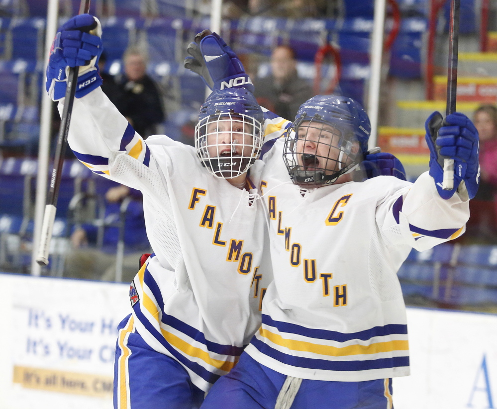 Christopher Camelio, left, of Falmouth celebrates with Andrew Clement on Saturday after Clement scored the winning goal against Noble/Wells late in the third period of a Western Class A semifinal at the Colisee in Lewiston. The Yachtsmen will face Scarborough in the regional final on Tuesday.