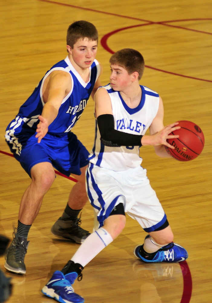 TOUGH D: Hodgdon's Chris Hudson guards Valley's Collin Miller during the Class D state championship game Saturday at Augusta Civic Center. Hodgdon won 51-46.