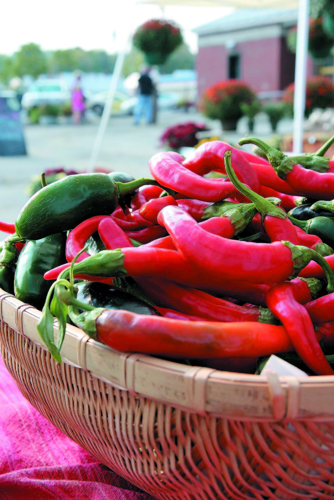 HOT DAY AT MARKET: Hot peppers from the One Drop Farm, in Cornville, await customers at the Skowhegan Farmers' Market.