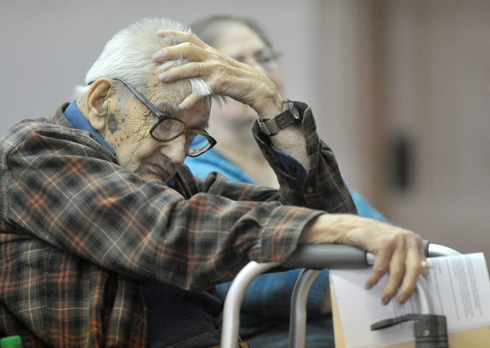 Life Attendant: Laurence Amazeen, 99, listens to the town meeting budget during the annual town meeting at the Cornville town Hall on Saturday. Amazeen also turned 99 on Saturday making him the oldest vote in the meeting.