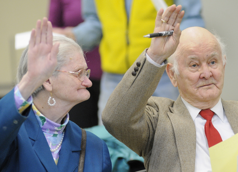 PARTY CAUCUS: Albert and Elizabeth Conary vote during the Democratic Party caucus Sunday in Gardiner. Members of the party met across Maine to meet candidates and elect officers for the upcoming campaign this fall.