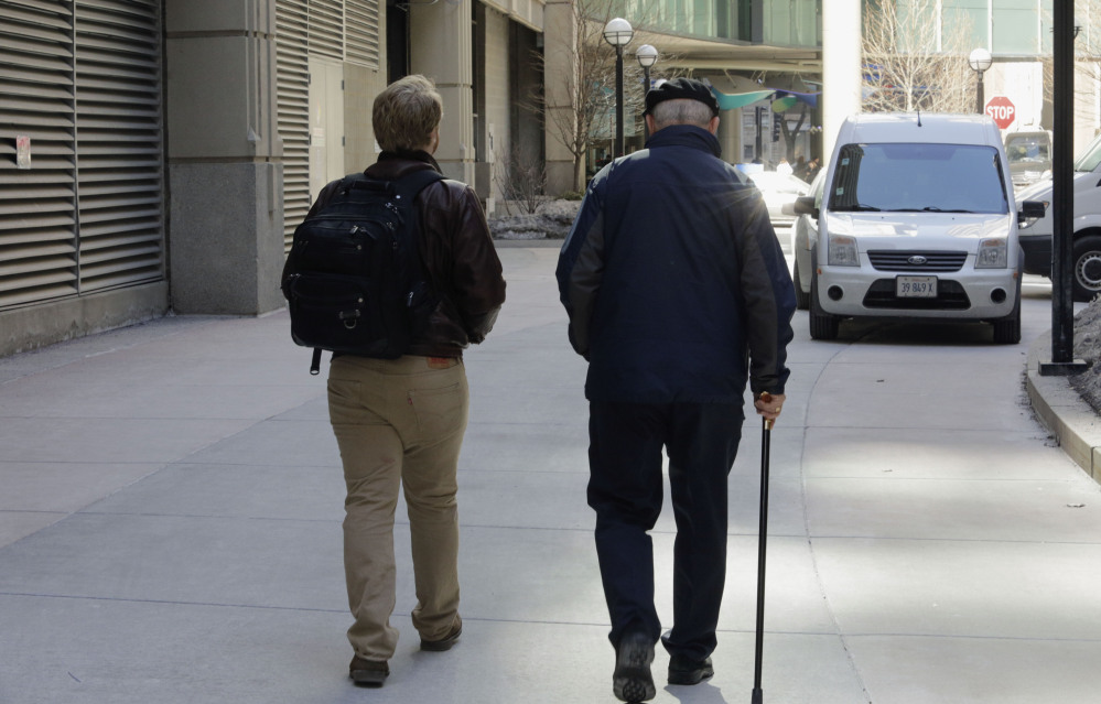 "First-year Northwestern University medical student Jared Worthington walks with his ""Alzheimer's buddy,"" retired physician Dan Winship in Chicago's Streeterville neighborhood."