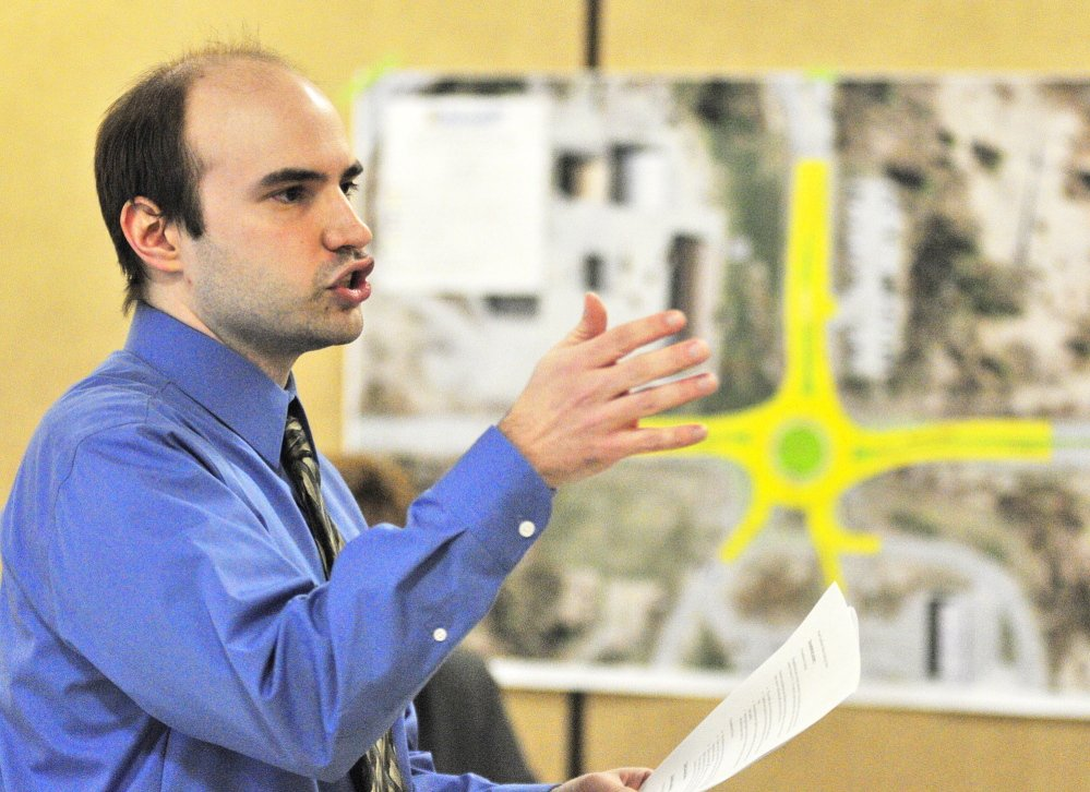 HOW IT WORKS: Jonathan French, a designer for the Department of Transportation, speaks on Tuesday at Helen Thompson School in West Gardiner during a public meeting held to hear reaction to a planned roundabout.