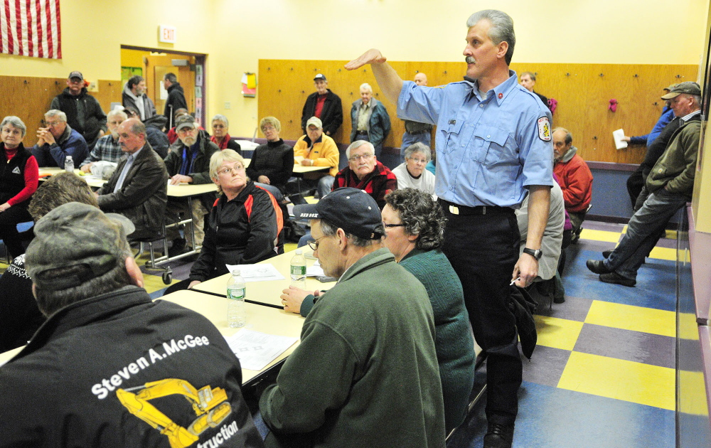 CONCERN: Mike Dovinsky speaks during a public meeting held Tuesday at Helen Thompson School in West Gardiner by the state Department of Transportation to hear reaction to a planned roundabout.