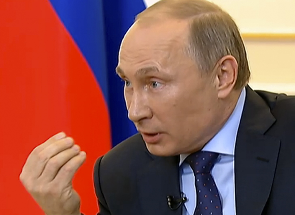 President Vladimir Putin answers journalists' questions on Ukraine on Russian television Tuesday.
