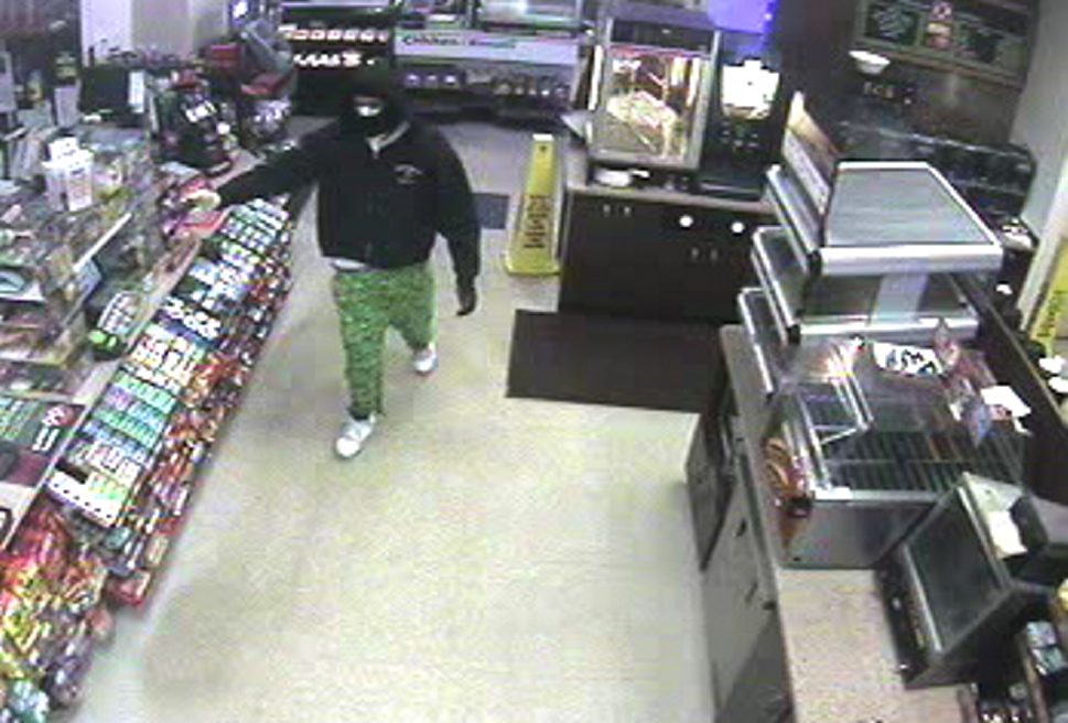Surveillance camera photo of suspected armed robber.